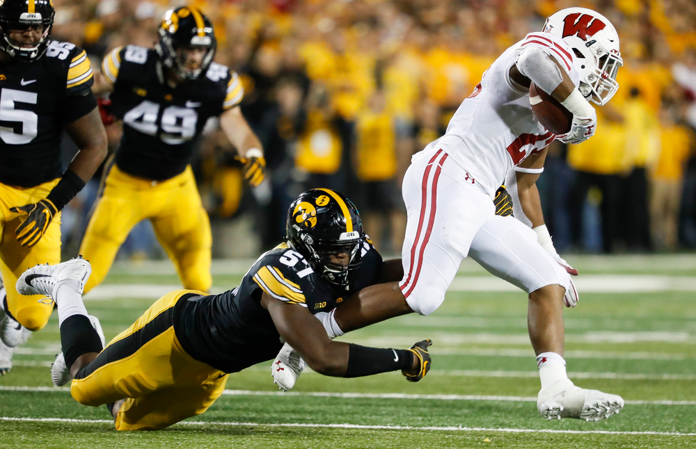 Iowa Hawkeyes defensive end Chauncey Golston (57) makes a tackle during a game against Wisconsin at Kinnick Stadium on September 22, 2018. (Tork Mason/hawkeyesports.com)