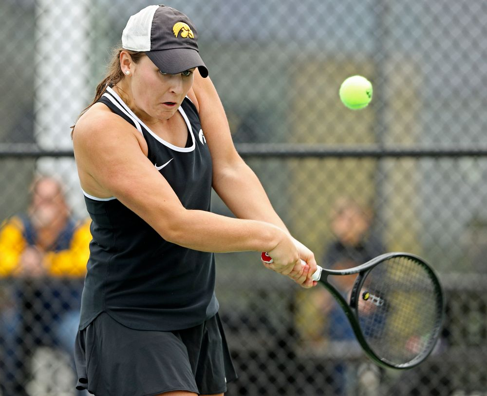 Iowa's Danielle Bauers returns a shot during their doubles match against Rutgers at the Hawkeye Tennis and Recreation Complex in Iowa City on Friday, Apr. 5, 2019. (Stephen Mally/hawkeyesports.com)