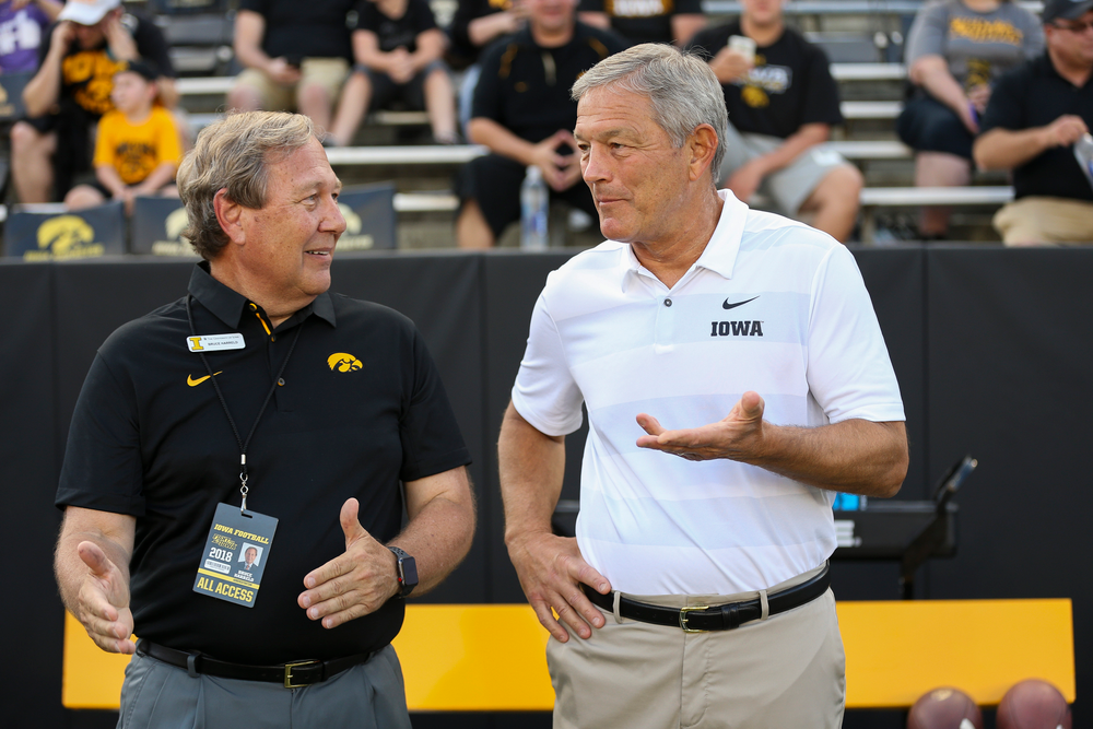 University of Iowa President Bruce Harreld and Iowa Hawkeyes head coach Kirk Ferentz talk before a game against Northern Iowa at Kinnick Stadium on September 15, 2018. (Tork Mason/hawkeyesports.com)