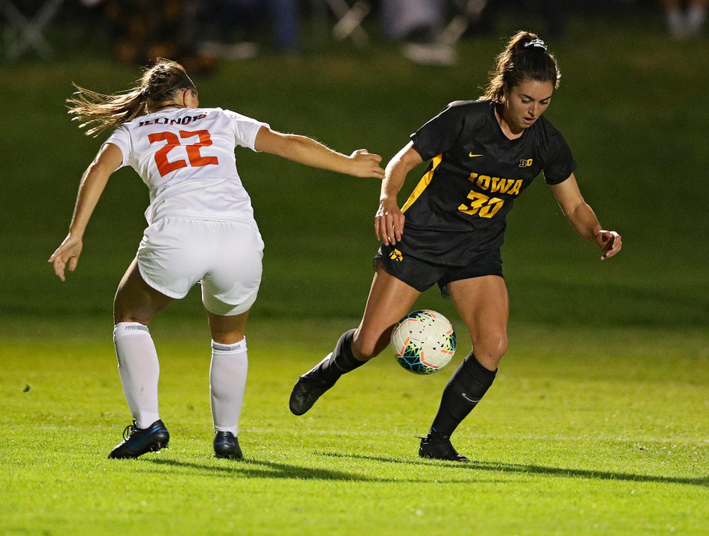 Iowa forward Devin Burns (30) gets around a defender during the first half of their match against Illinois at the Iowa Soccer Complex in Iowa City on Thursday, Sep 26, 2019. (Stephen Mally/hawkeyesports.com)
