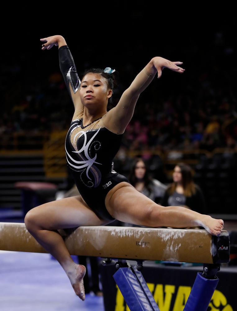Iowa's Misty-Jade Carlson competes on the beam against the Nebraska Cornhuskers