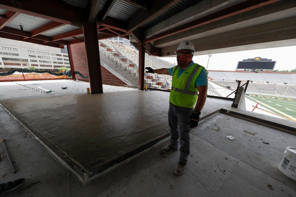 University of Iowa Senior Construction Project Manager Michael Kearns talks about the outdoor patio area in the northeast cover of the north end zone Wednesday, June 6, 2018 at Kinnick Stadium. (Brian Ray/hawkeyesports.com)