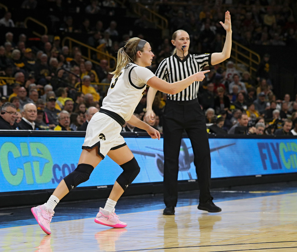 Iowa Hawkeyes guard Makenzie Meyer (3) points after making a 3-pointer during the second quarter of their game at Carver-Hawkeye Arena in Iowa City on Sunday, January 26, 2020. (Stephen Mally/hawkeyesports.com)