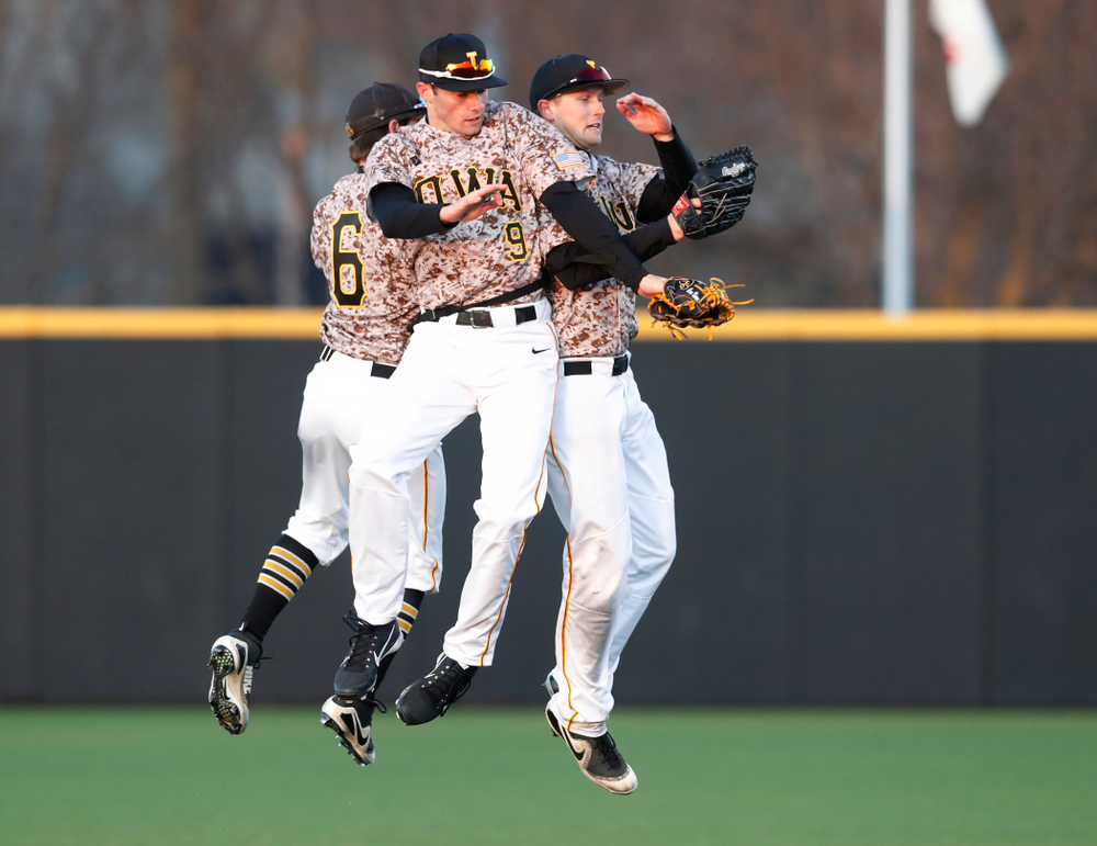 Iowa Hawkeyes outfielder Justin Jenkins (6), outfielder Ben Norman (9), and outfielder Robert Neustrom (44) against the Ohio State Buckeyes Saturday, April 7, 2018 at Duane Banks Field. (Brian Ray/hawkeyesports.com)
