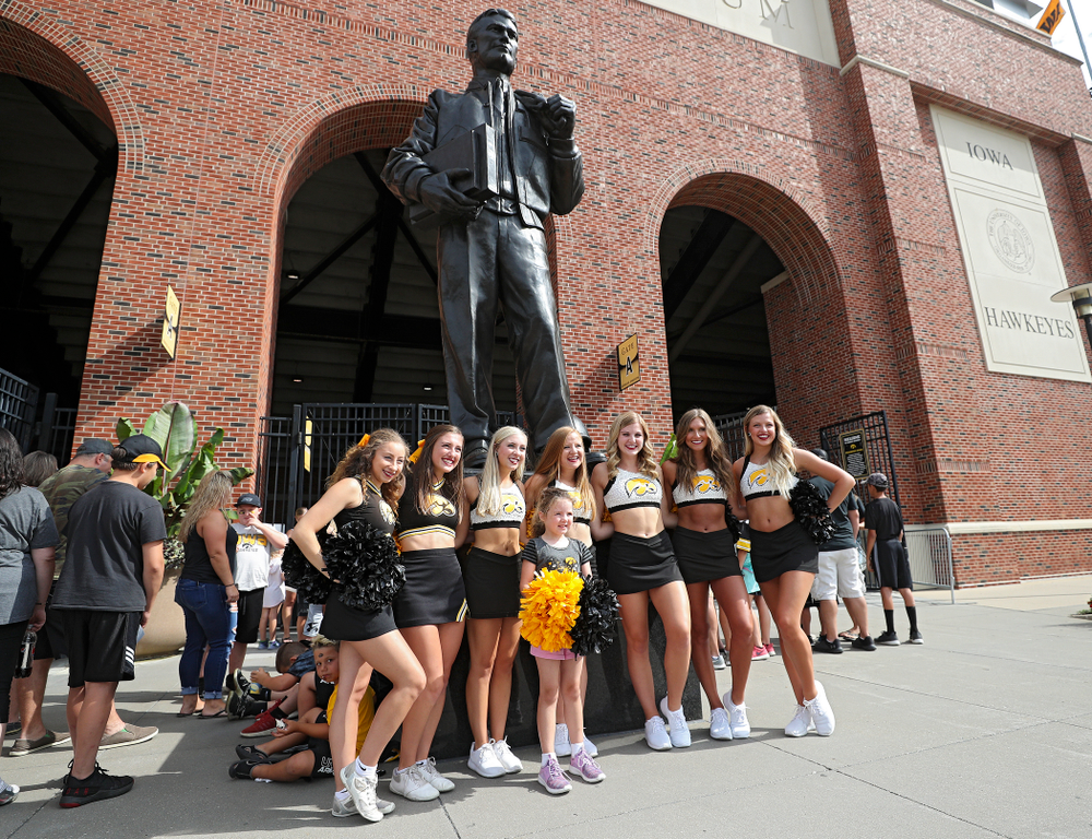 A fan takes a picture with Iowa Spirit Squad members during Kids Day at Kinnick Stadium in Iowa City on Saturday, Aug 10, 2019. (Stephen Mally/hawkeyesports.com)