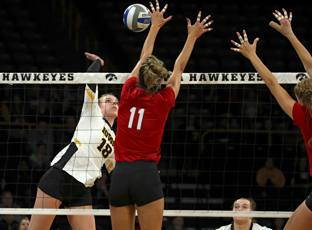 Iowa's Hannah Clayton (18) goes up for a kill during the first set of their match against Nebraska at Carver-Hawkeye Arena in Iowa City on Saturday, Nov 9, 2019. (Stephen Mally/hawkeyesports.com)