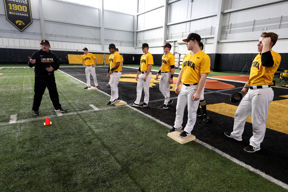 Iowa Hawkeyes assistant coach Marty Sutherland runs a base running drill during practice Thursday, February 6, 2020 at the Indoor Practice Facility. (Brian Ray/hawkeyesports.com)