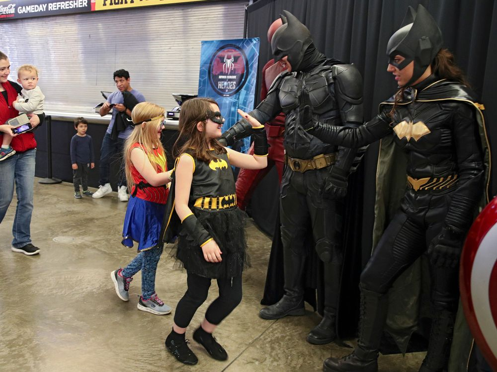 Two young fans greet superheroes on Superhero and Princess Day before the meet at Carver-Hawkeye Arena in Iowa City on Sunday, March 8, 2020. (Stephen Mally/hawkeyesports.com)