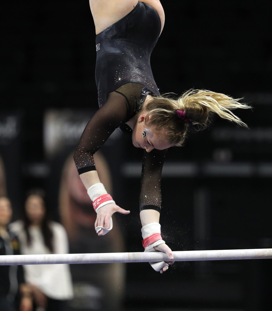 Iowa's Charlotte Sullivan competes on the bars during their meet against the Minnesota Golden Gophers Saturday, January 19, 2019 at Carver-Hawkeye Arena. (Brian Ray/hawkeyesports.com)
