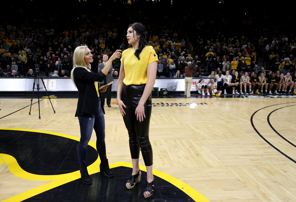 Megan Gustafson is interviewed by Laura Vandeberg during a jersey retirement ceremony Sunday, January 26, 2020 at Carver-Hawkeye Arena. (Brian Ray/hawkeyesports.com)