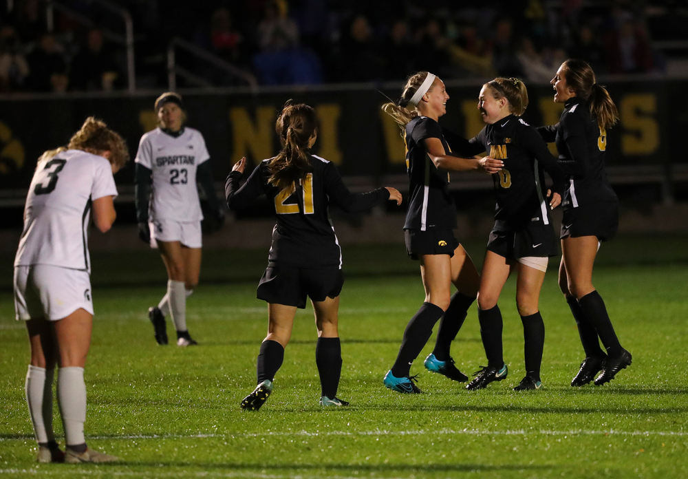 Iowa Hawkeyes midfielder Hailey Rydberg (2), Iowa Hawkeyes midfielder Natalie Winters (10) and Iowa Hawkeyes midfielder Isabella Blackman (6) celebrate after Rydberg's goal during a game against Michigan State at the Iowa Soccer Complex on October 12, 2018. (Tork Mason/hawkeyesports.com)