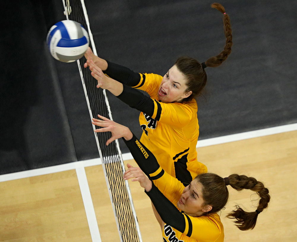 Iowa's Courtney Buzzerio (2) and Blythe Rients (11) try to block a shot during the fourth set of their match at Carver-Hawkeye Arena in Iowa City on Friday, Nov 29, 2019. (Stephen Mally/hawkeyesports.com)