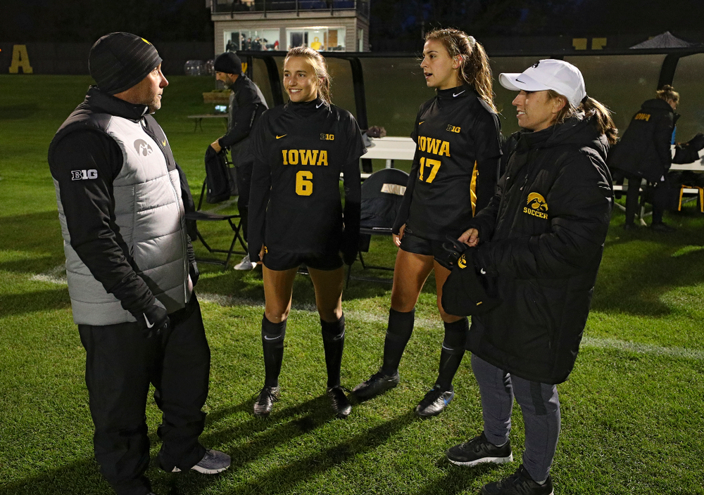 Iowa head coach Dave DiIanni talks with midfielder Isabella Blackman (6), defender Hannah Drkulec (17), and assistant coach Katelyn Longino before their match at the Iowa Soccer Complex in Iowa City on Friday, Oct 11, 2019. (Stephen Mally/hawkeyesports.com)