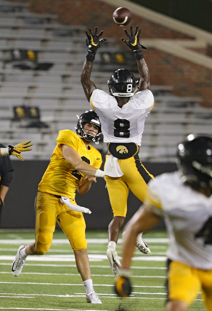 Iowa Hawkeyes quarterback Peyton Mansell (2) throws a pass just over the hands of defensive back Matt Hankins (8) during Fall Camp Practice No. 12 at Kinnick Stadium in Iowa City on Thursday, Aug 15, 2019. (Stephen Mally/hawkeyesports.com)