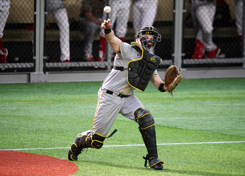 Iowa Hawkeyes catcher Brett McCleary (32) throws during the eighth inning of their CambriaCollegeClassic game at U.S. Bank Stadium in Minneapolis, Minn. on Friday, February 28, 2020. (Stephen Mally/hawkeyesports.com)