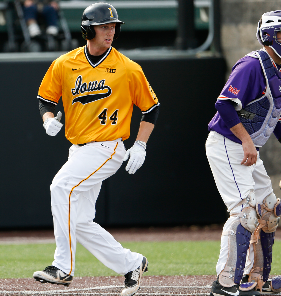 Iowa Hawkeyes outfielder Robert Neustrom (44) comes in to score during a game against Evansville at Duane Banks Field on March 18, 2018. (Tork Mason/hawkeyesports.com)