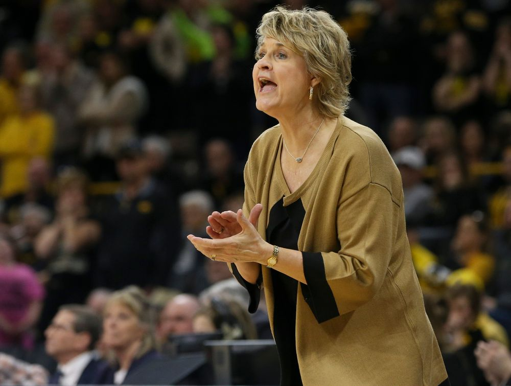 Iowa Hawkeyes head coach Lisa Bluder communicates with her team during the first round of the 2019 NCAA Women's Basketball Tournament at Carver Hawkeye Arena in Iowa City on Friday, Mar. 22, 2019. (Stephen Mally for hawkeyesports.com)