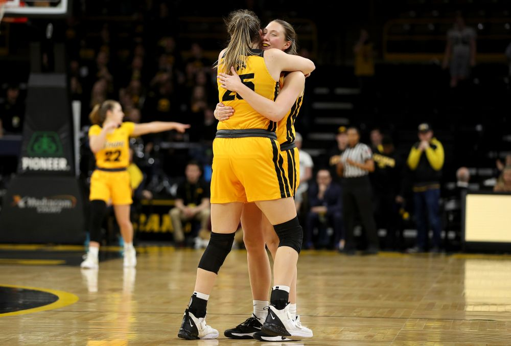 Iowa Hawkeyes forward Amanda Ollinger (43) and forward/center Monika Czinano  against the Minnesota Golden Gophers Thursday, February 27, 2020 at Carver-Hawkeye Arena. (Brian Ray/hawkeyesports.com)