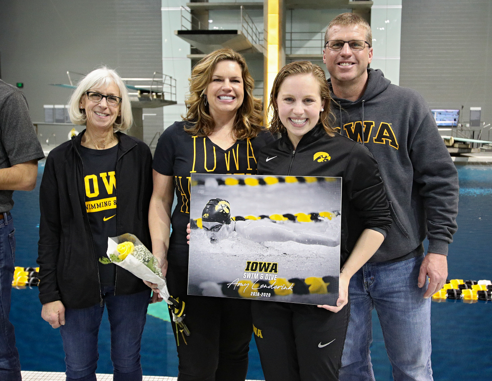 Iowa's Amy Lenderink is honored on senior day before their meet at the Campus Recreation and Wellness Center in Iowa City on Friday, February 7, 2020. (Stephen Mally/hawkeyesports.com)
