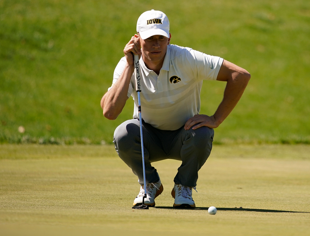 Iowa's Aaron DeNucci lines up a putt during the second round of the Hawkeye Invitational at Finkbine Golf Course in Iowa City on Saturday, Apr. 20, 2019. (Stephen Mally/hawkeyesports.com)