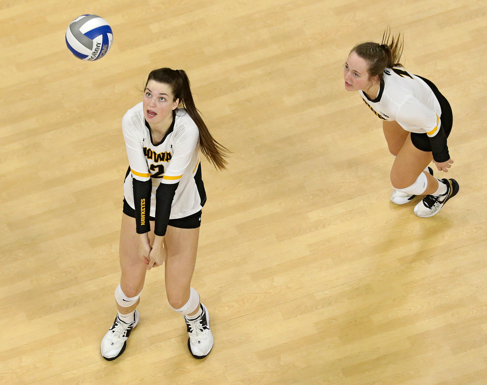 Iowa's Courtney Buzzerio (from left) prepares to bump the ball as Joslyn Boyer looks on during the second set of their match at Carver-Hawkeye Arena in Iowa City on Saturday, Nov 30, 2019. (Stephen Mally/hawkeyesports.com)