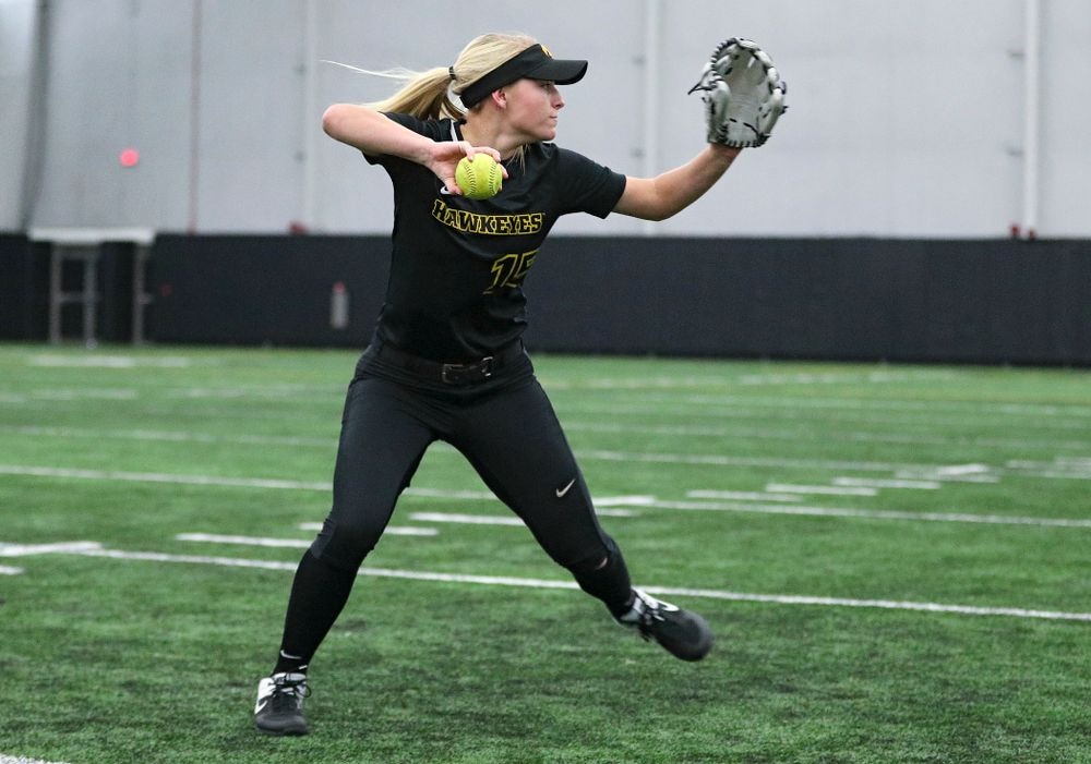 Iowa infielder Erin Carter (15) throws to first base as they run a drill during Iowa Softball Media Day at the Hawkeye Tennis and Recreation Complex in Iowa City on Thursday, January 30, 2020. (Stephen Mally/hawkeyesports.com)