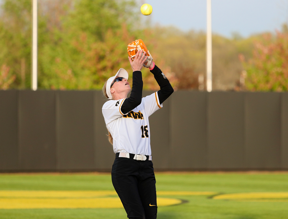 Iowa shortstop Ashley Hamilton (18) pulls in a pop up for an out during the seventh inning of their game against Ohio State at Pearl Field in Iowa City on Friday, May. 3, 2019. (Stephen Mally/hawkeyesports.com)