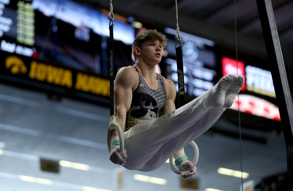 Iowa's Stewart Brown competes on the Rings against UIC and Minnesota Saturday, February 1, 2020 at Carver-Hawkeye Arena. (Brian Ray/hawkeyesports.com)