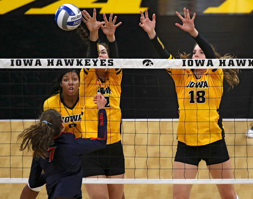 Iowa's Courtney Buzzerio (2) blocks a shot as Hannah Clayton (18) looks on during the first set of their match against Illinois at Carver-Hawkeye Arena in Iowa City on Wednesday, Nov 6, 2019. (Stephen Mally/hawkeyesports.com)