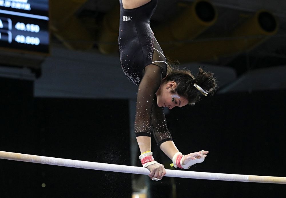 Iowa's Carina Tolan competes on the bars during their meet at Carver-Hawkeye Arena in Iowa City on Sunday, March 8, 2020. (Stephen Mally/hawkeyesports.com)