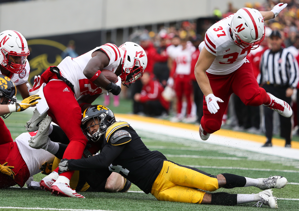 Iowa Hawkeyes defensive back Josh Turner (4) makes a tackle on a kickoff return