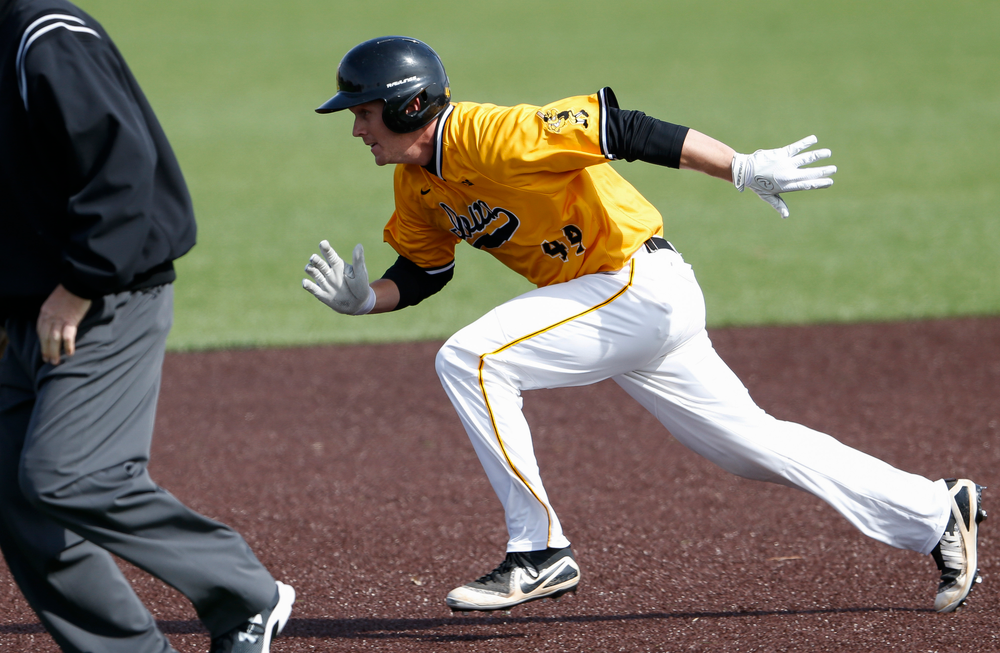 Iowa Hawkeyes outfielder Robert Neustrom (44) runs to second base during a game against Evansville at Duane Banks Field on March 18, 2018. (Tork Mason/hawkeyesports.com)