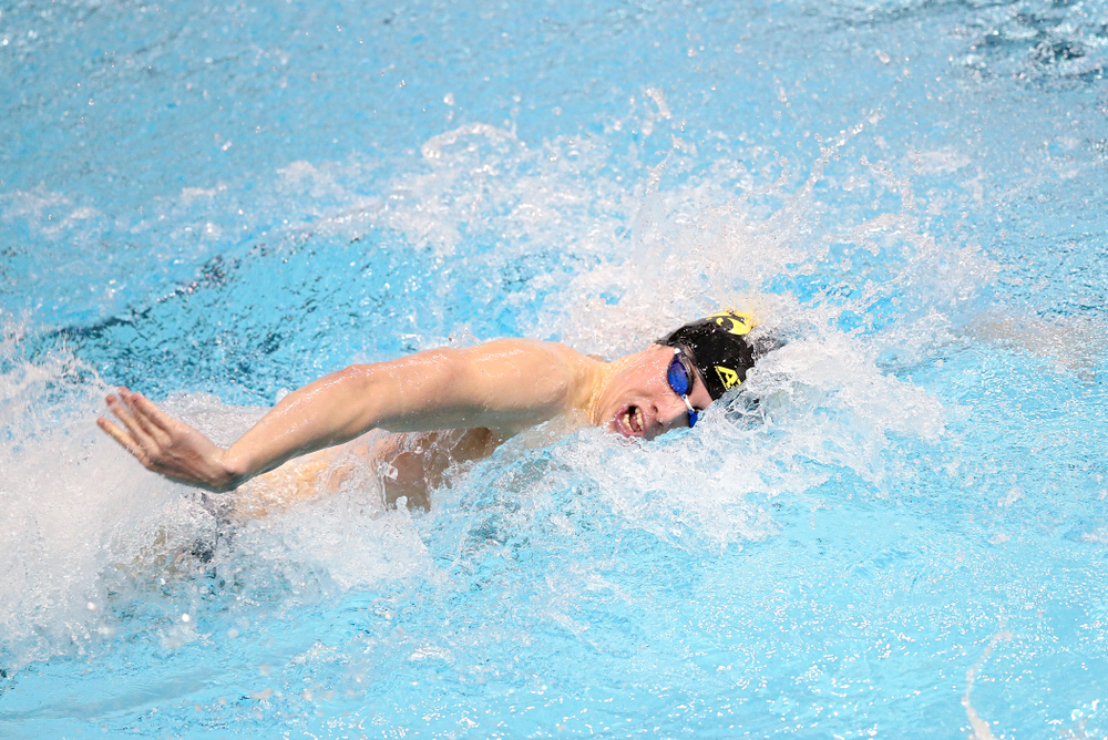 Iowa's Dolan Craine swims the men's 100 yard individual medley event during their meet at the Campus Recreation and Wellness Center in Iowa City on Friday, February 7, 2020. (Stephen Mally/hawkeyesports.com)