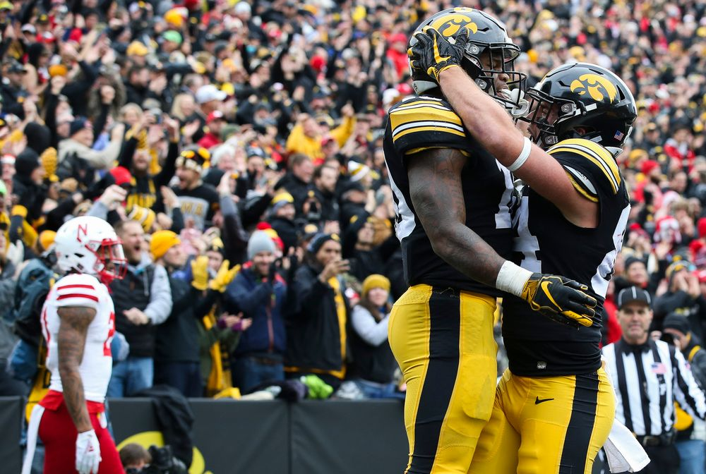 Iowa Hawkeyes running back Mekhi Sargent (10) and Iowa Hawkeyes wide receiver Nick Easley (84) celebrate after Sargent's touchdown during a game against Nebraska at Kinnick Stadium on November 23, 2018. (Tork Mason/hawkeyesports.com)