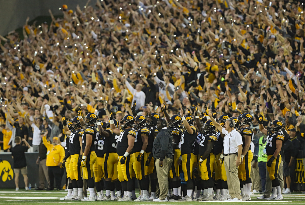The Iowa Hawkeyes wave to the University of Iowa Stead Family Children's Hospital between the first and second quarter of their game at Kinnick Stadium in Iowa City on Saturday, Aug 31, 2019. (Stephen Mally/hawkeyesports.com)