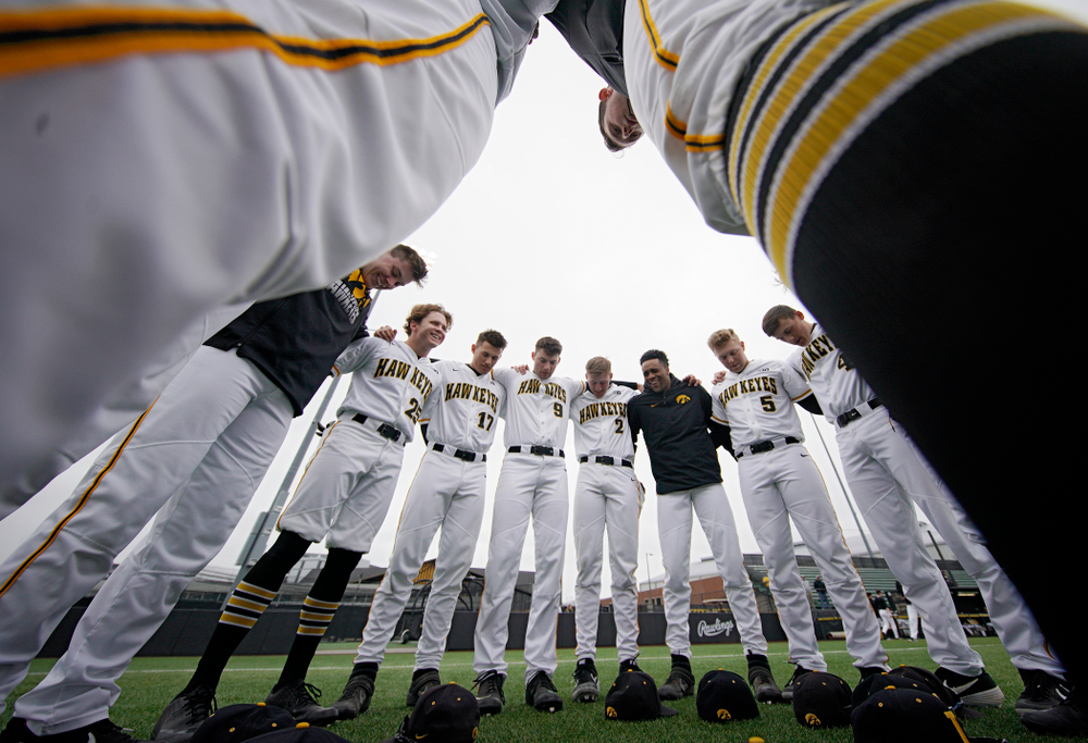 The Hawkeyes huddle before their college baseball game at Duane Banks Field in Iowa City on Wednesday, March 11, 2020. (Stephen Mally/hawkeyesports.com)