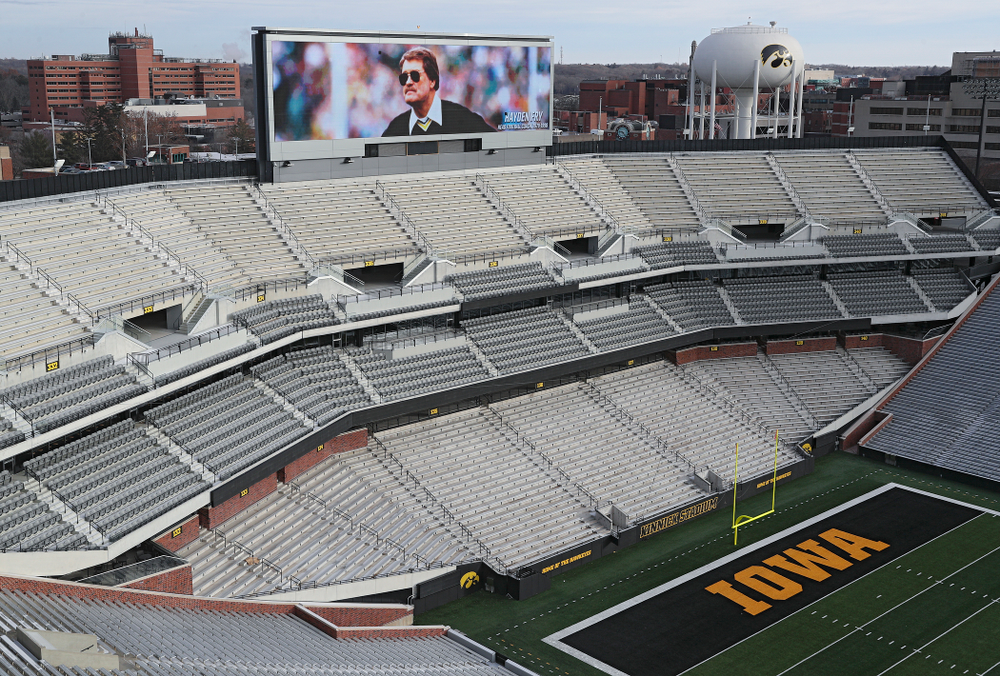 A picture of Hayden Fry is shown on the video boards at Kinnick Stadium in Iowa City on Wednesday, December 18, 2019. Hayden Fry passed away on Dec. 17, at the age of 90. (Stephen Mally/hawkeyesports.com)