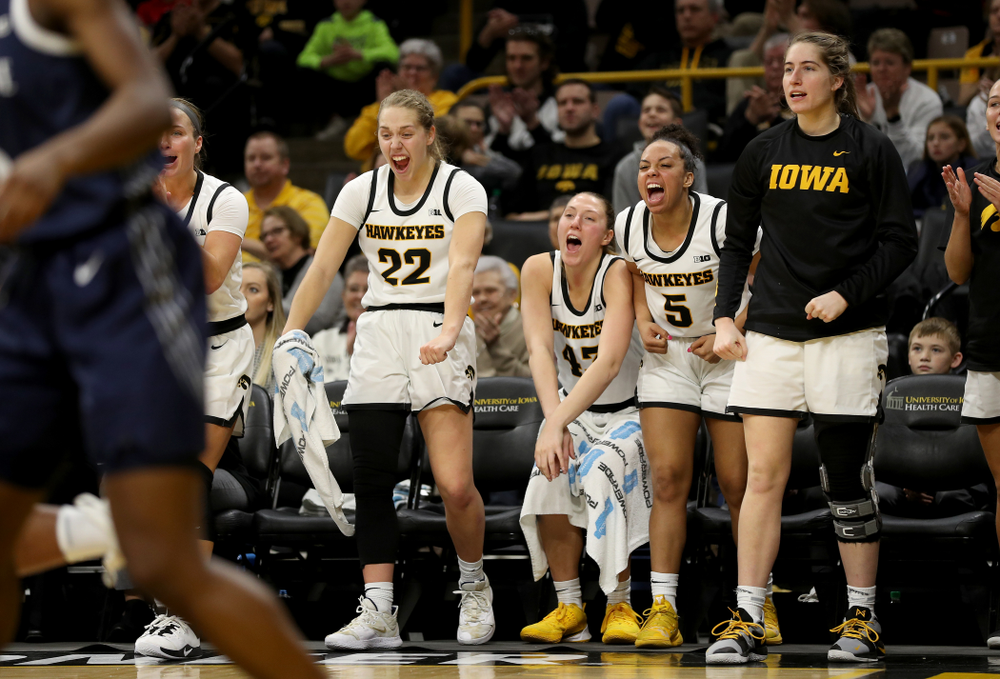 Iowa Hawkeyes guard Kathleen Doyle (22), forward Amanda Ollinger (43), guard Alexis Sevillian (5), and guard Kate Martin (20) against Penn State Saturday, February 22, 2020 at Carver-Hawkeye Arena. (Brian Ray/hawkeyesports.com)