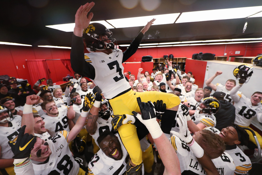The Iowa Hawkeyes hoist up place kicker Keith Duncan (3) as they celebrate their victory against the Nebraska Cornhuskers Friday, November 29, 2019 at Memorial Stadium in Lincoln, Neb. (Brian Ray/hawkeyesports.com)