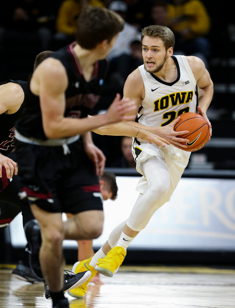 Iowa Hawkeyes forward Riley Till (20) brings the ball upcourt during a game against Guilford College at Carver-Hawkeye Arena on November 4, 2018. (Tork Mason/hawkeyesports.com)