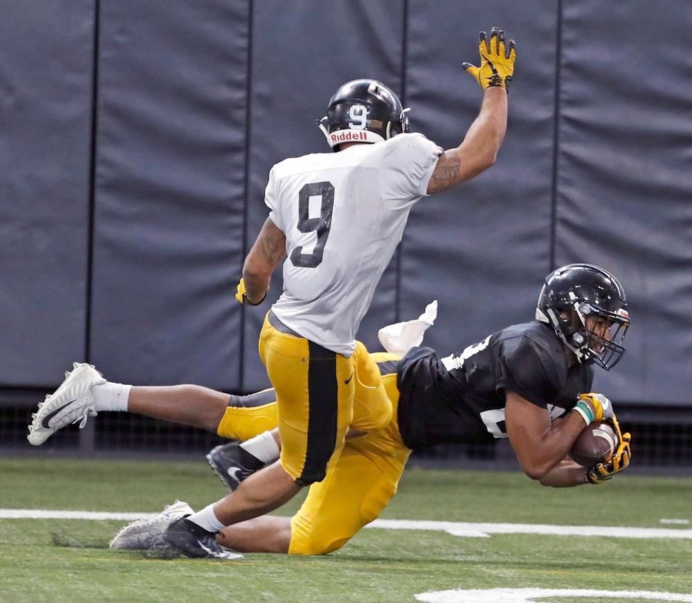 Dominique Dafney, Geno Stone -- University of Iowa spring football practice No. 6 on March 31, 2018, in Iowa City, Iowa. (Darren Miller/hawkeyesports.com)