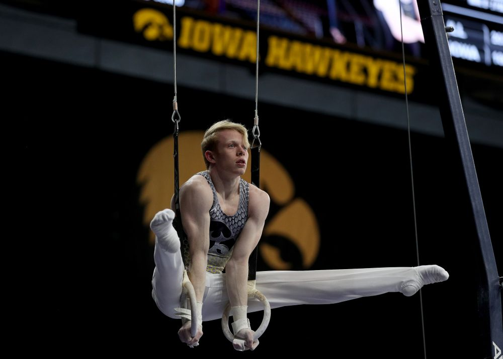 Iowa's Nick Merryman competes on the rings against Illinois Sunday, March 1, 2020 at Carver-Hawkeye Arena. (Brian Ray/hawkeyesports.com)