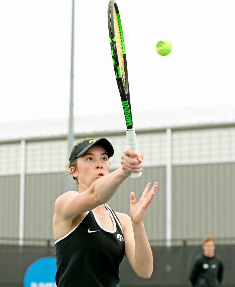 Iowa's Samantha Mannix returns a shot during their doubles match against Rutgers at the Hawkeye Tennis and Recreation Complex in Iowa City on Friday, Apr. 5, 2019. (Stephen Mally/hawkeyesports.com)