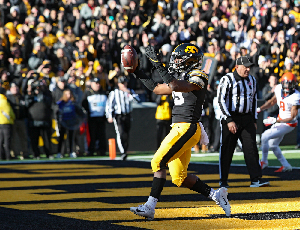 Iowa Hawkeyes running back Tyler Goodson (15) celebrates after scoring a touchdown during the first quarter of their game at Kinnick Stadium in Iowa City on Saturday, Nov 23, 2019. (Stephen Mally/hawkeyesports.com)