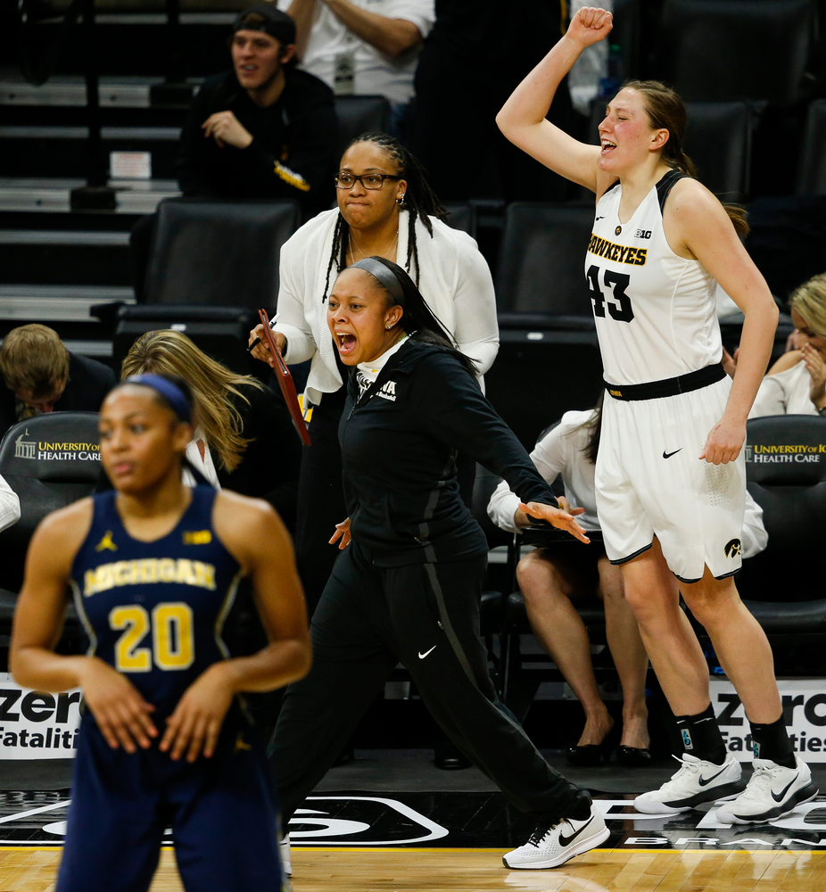 Iowa Hawkeyes guard Tania Davis (11), Iowa Hawkeyes forward Amanda Ollinger (43)