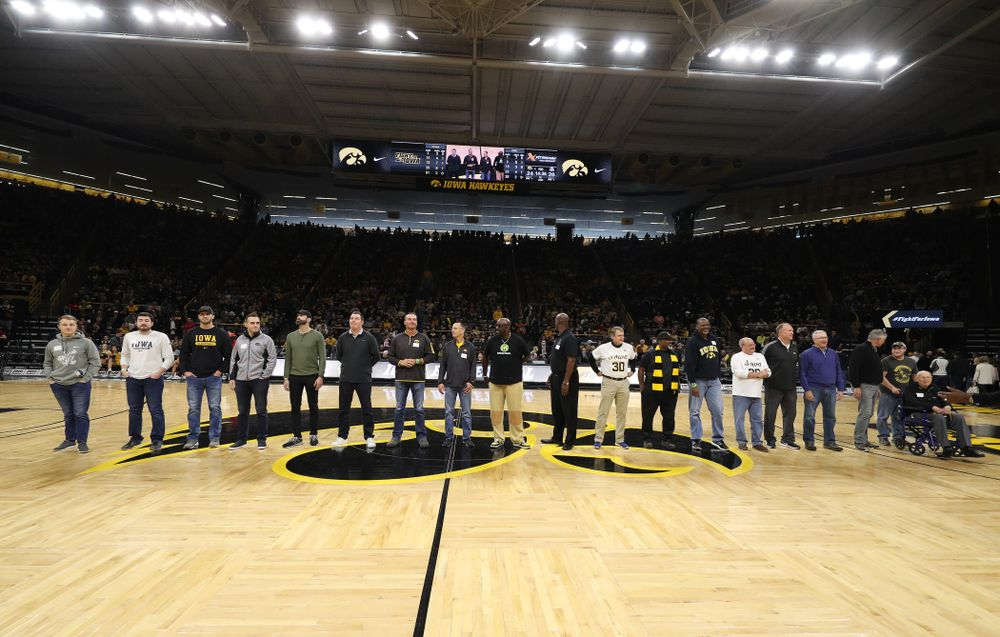 Former Iowa Hawkeye letterman are recognized during half-time against the Ohio State Buckeyes Saturday, January 12, 2019 at Carver-Hawkeye Arena. (Brian Ray/hawkeyesports.com)