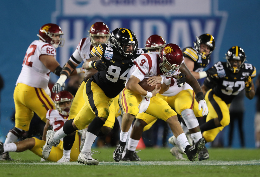 Iowa Hawkeyes defensive end A.J. Epenesa (94) gets a sack against USC in the Holiday Bowl Friday, December 27, 2019 at San Diego Community Credit Union Stadium.  (Brian Ray/hawkeyesports.com)