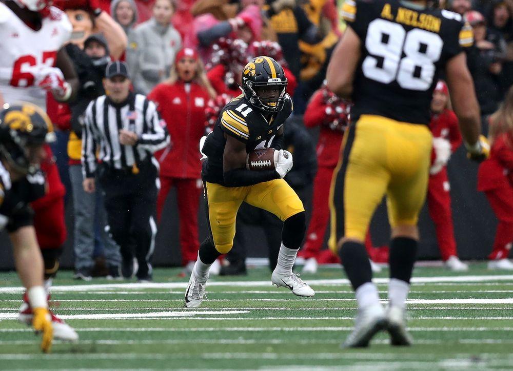 Iowa Hawkeyes defensive back Michael Ojemudia (11) intercepts a pass against the Nebraska Cornhuskers Friday, November 23, 2018 at Kinnick Stadium. (Brian Ray/hawkeyesports.com)