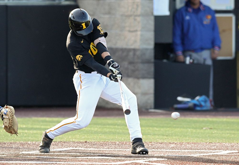 Iowa shortstop Dylan Nedved (17) hits an RBI single during the third inning of their college baseball game at Duane Banks Field in Iowa City on Tuesday, March 10, 2020. (Stephen Mally/hawkeyesports.com)