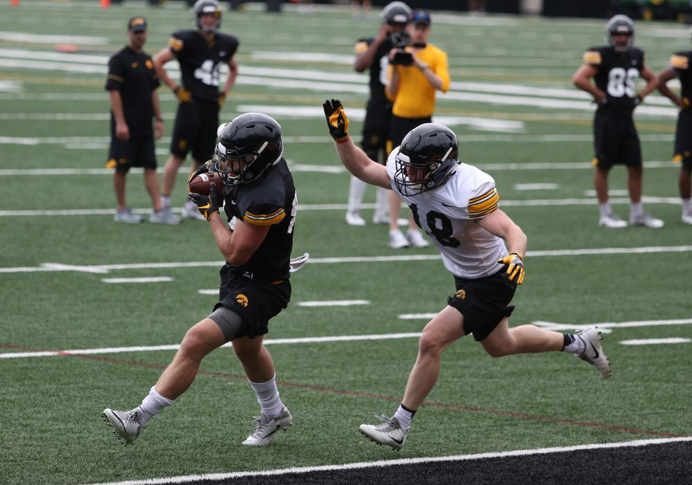 and defensive back John Milani (18) during practice No. 4 of Fall Camp Monday, August 6, 2018 at the Hansen Football Performance Center. (Brian Ray/hawkeyesports.com)